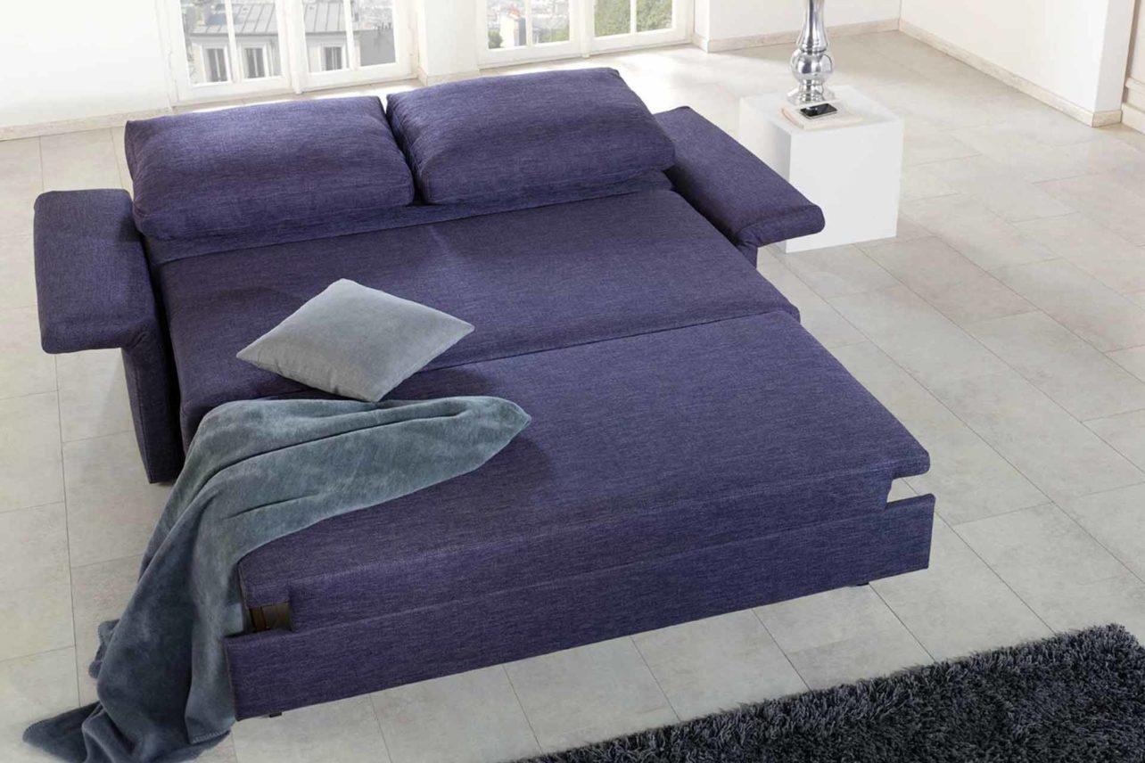 Schlafsofa Cala lila mit abgebildeter Schlaffunktion